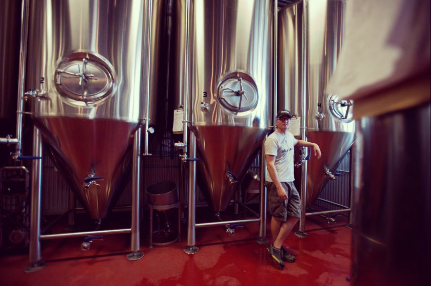 Bobby in front of the fermentation tanks at HooDoo.