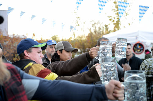 Stein holding competition for men and women takes place each Saturday during Oktoberfest. [Photo by Nate H.]